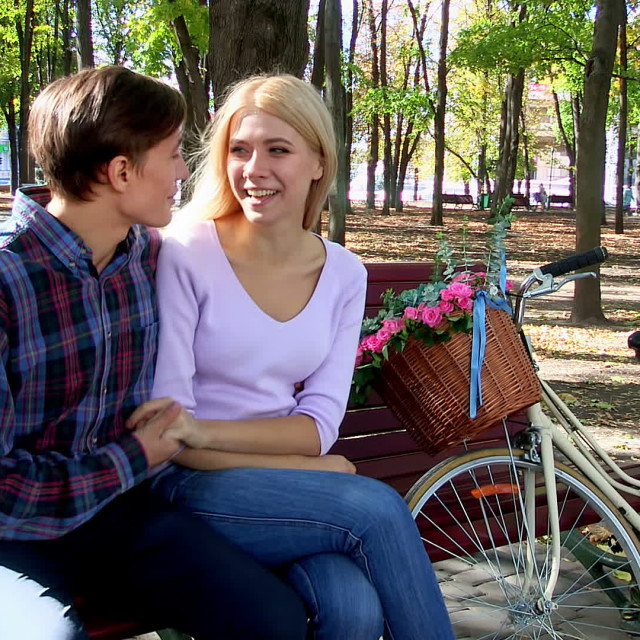 """""""Couple with retro bike in the park on bench."""" stock image"""