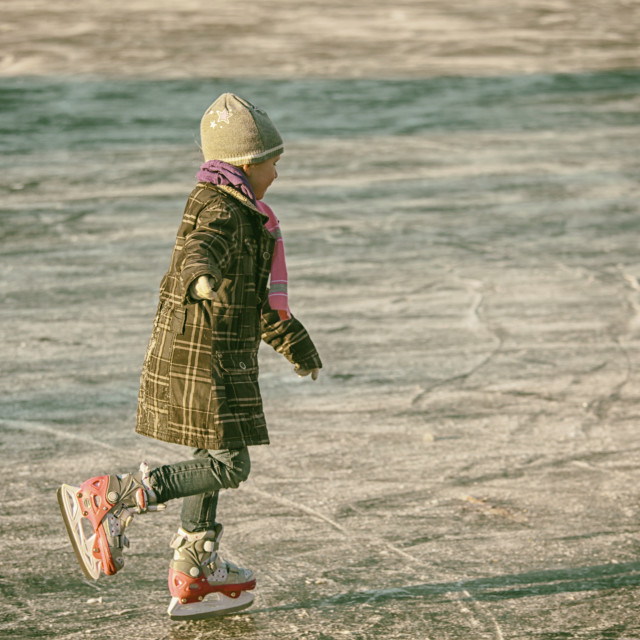 """Girl ice skating"" stock image"