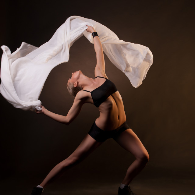 """beautiful woman in motion holding fabric"" stock image"