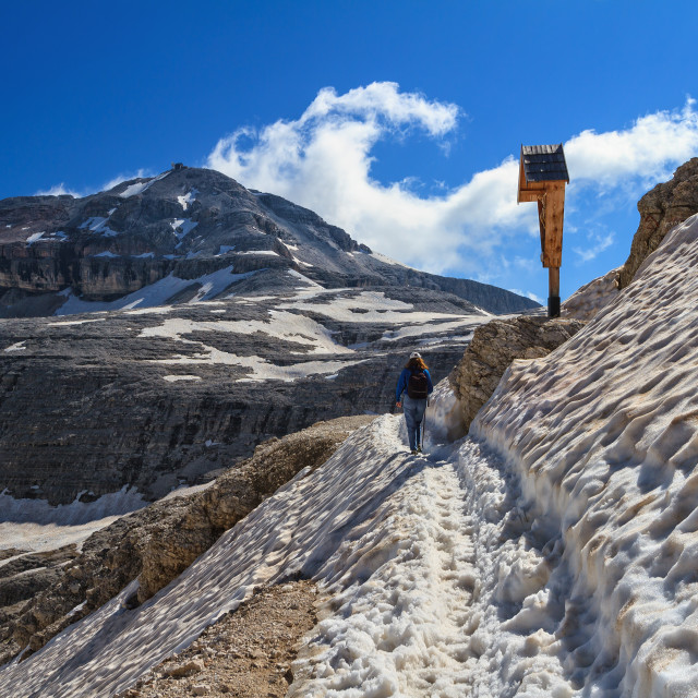 """Dolomiti - hiker on snowvy path"" stock image"