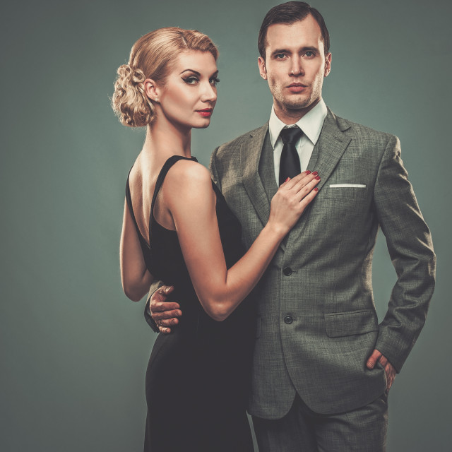 """Well-dressed retro couple"" stock image"