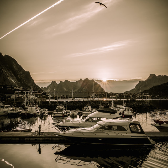 """Yachts and boats near moorage at sunset in Reine village, Norway"" stock image"