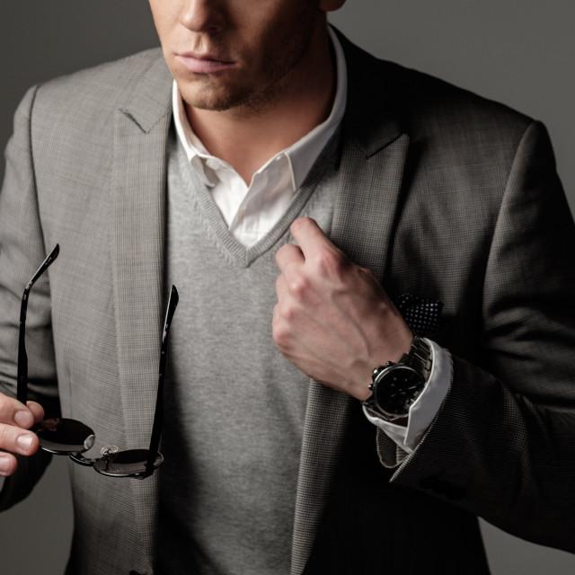 """Confident sharp dressed man in black suit"" stock image"