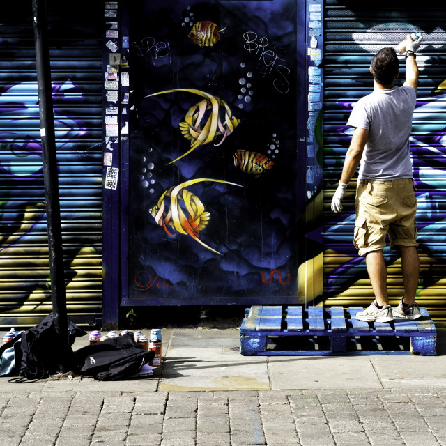 """Spray Painting on Brick Lane"" stock image"