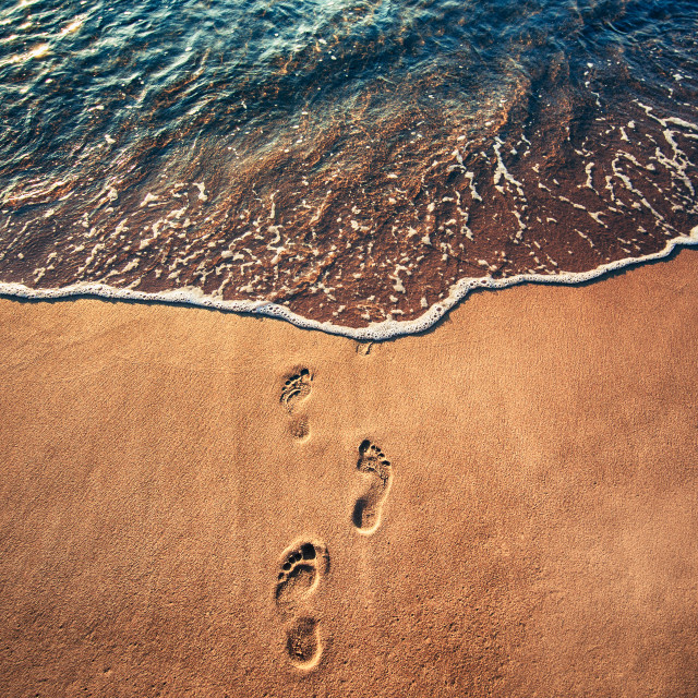 """Footsteps on the beach"" stock image"