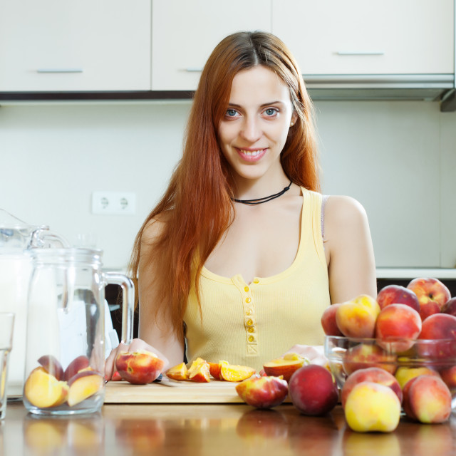 """pretty woman cooking beverages with peaches"" stock image"