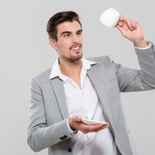 """""""Handsome man holding empty cup"""" stock image"""