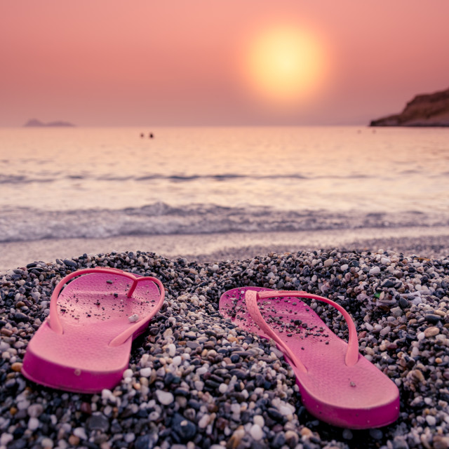 """Flip flops on the beach at sunset"" stock image"