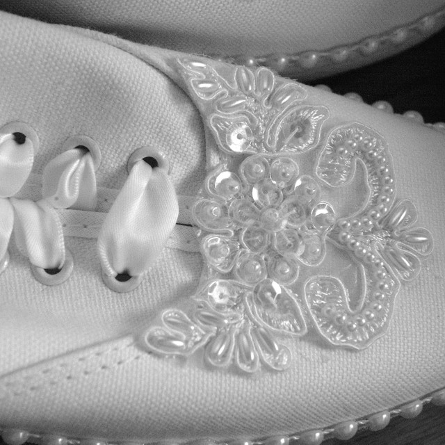 """""""The toes of white wedding tennis shoes with sequins on them in black and white."""" stock image"""