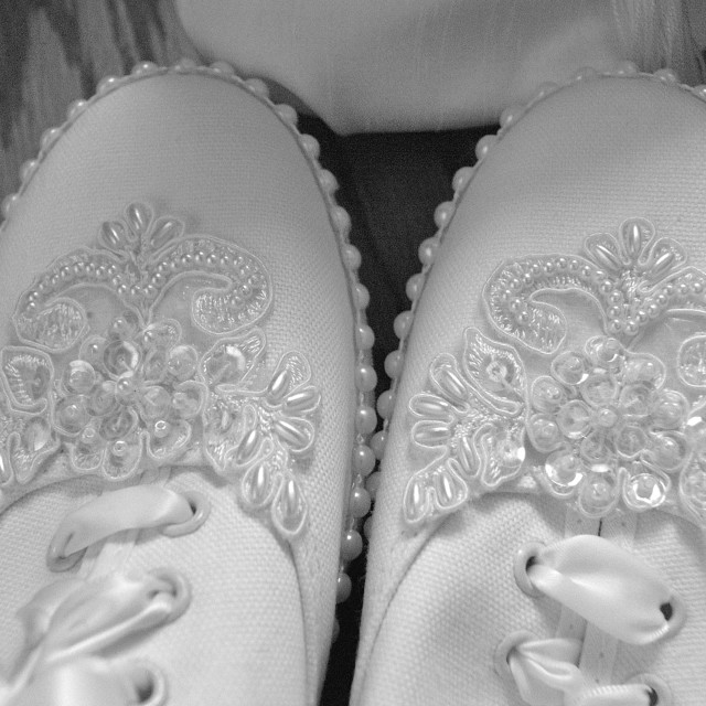"""""""The toe of a white wedding tennis shoes with sequins on it in black and white."""" stock image"""