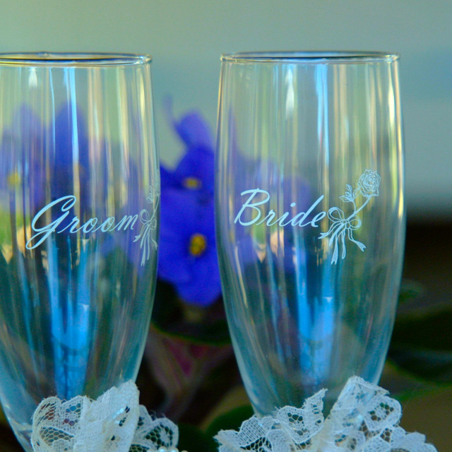 """""""Bride and groom toasting glasses at a wedding"""" stock image"""