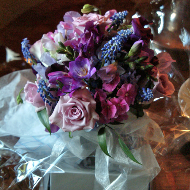 """""""A wedding floral decoration of various flowers displayed on a table"""" stock image"""