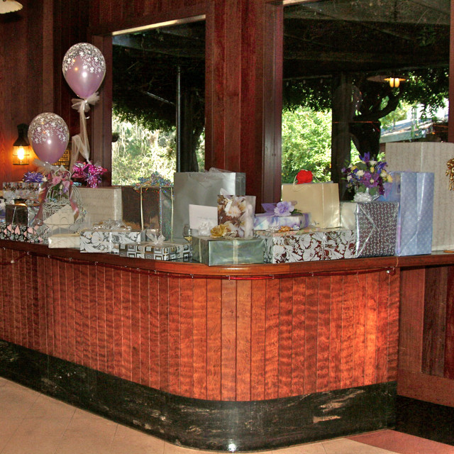 """""""Gift display on a bar at the reception of a wedding"""" stock image"""