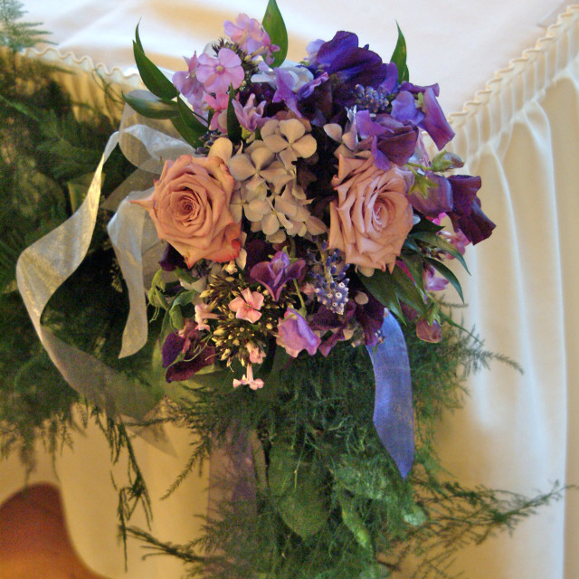 """""""A wedding floral decoration of various flowers displayed on the corner of a..."""" stock image"""