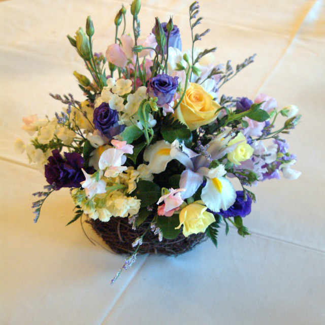 """""""A wedding floral centerpiece in the middle of a table at a wedding reception"""" stock image"""