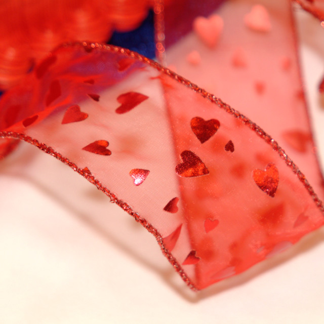 """""""Red wired ribbon with small hearts on it"""" stock image"""