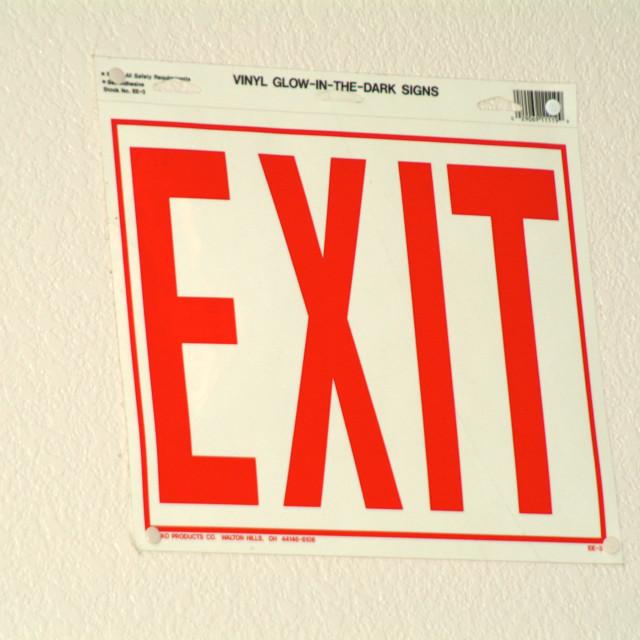 """""""A exit sign on the wall"""" stock image"""