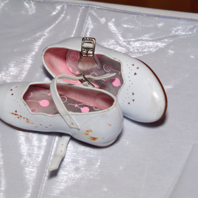 """""""Junior bridesmaids shoes scuffed after wearing at a wedding."""" stock image"""