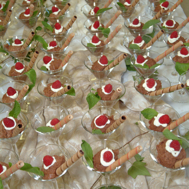 """""""Dessert display at a catered event of chocolate mousse, whipped cream, red..."""" stock image"""