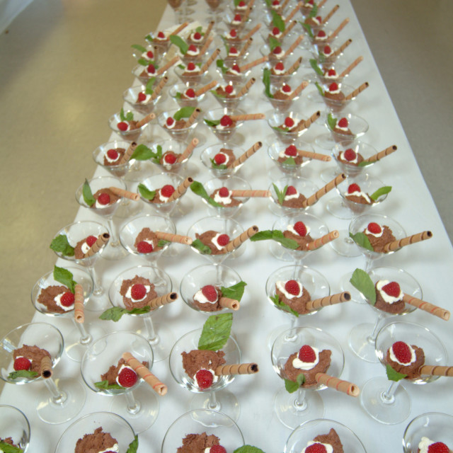 """""""Dessert display on along table at a catered event of chocolate mousse,..."""" stock image"""