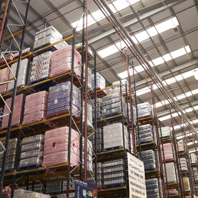 """Stored merchandise in a distribution warehouse, low angle"" stock image"