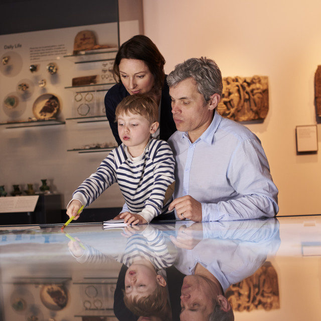 """""""Family On Trip To Museum Looking At Map Together"""" stock image"""
