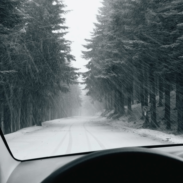 """Driving in the snowy storm"" stock image"