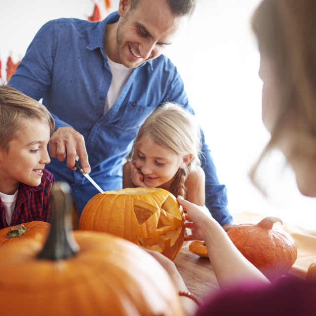"""""""Father helping in drilling pumpkins"""" stock image"""