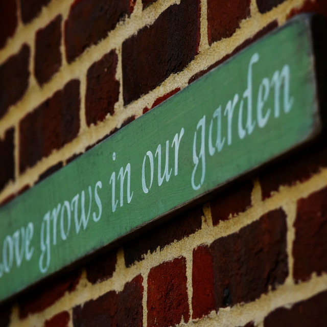 """Garden wall plaque"" stock image"