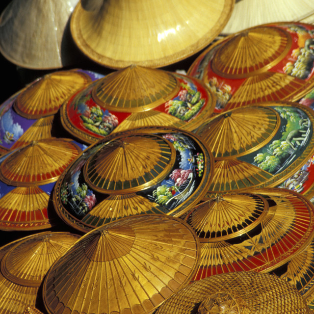 """Pile of Straw Hats, Thailand"" stock image"
