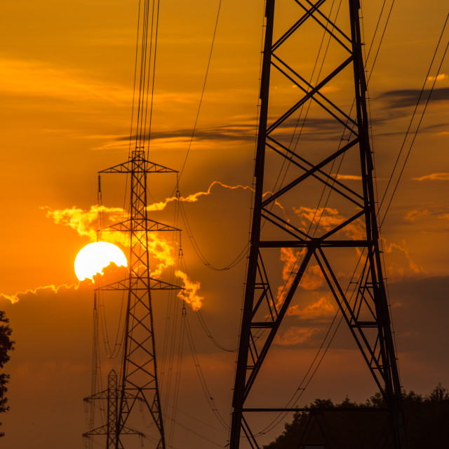 """Sunrise Behind Electricity Pylons"" stock image"