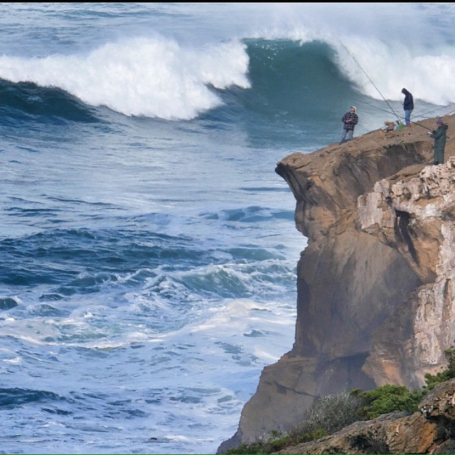 """""""Fishing from the cliffs"""" stock image"""