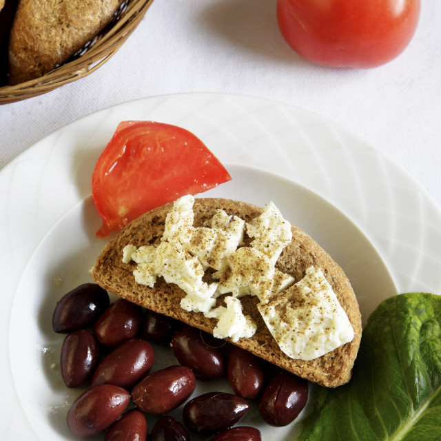 """Greek Cuisine. Cretan Dakos. Barley Rusk with Feta, Olives, Tomatoes and Oregano"" stock image"