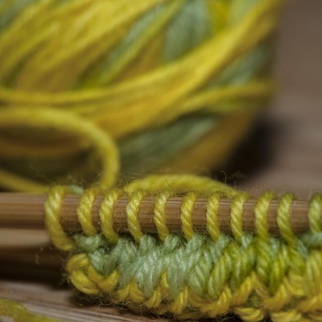 """Knitting on the needles"" stock image"