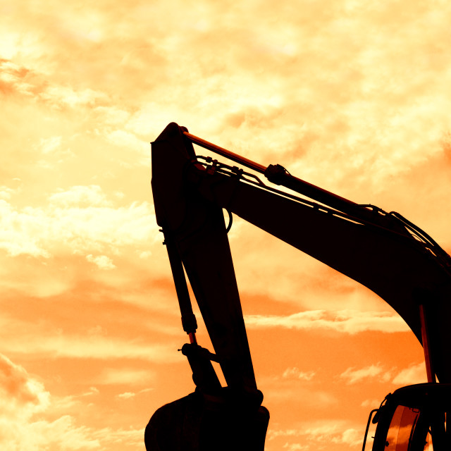 """digger shovel under red sky"" stock image"