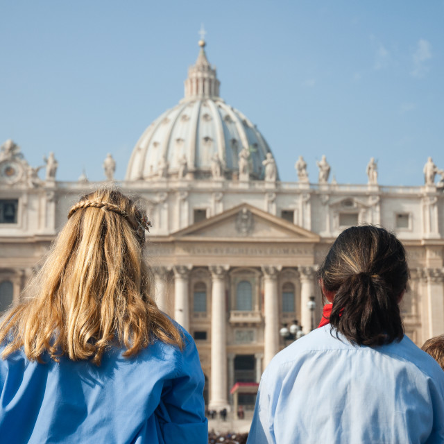 """""""St Peter Cathedral external view with two young people"""" stock image"""
