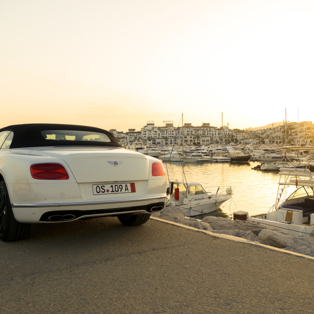 """Bentley parked in luxury Marina Puerto Banus, Marbella, Spain"" stock image"