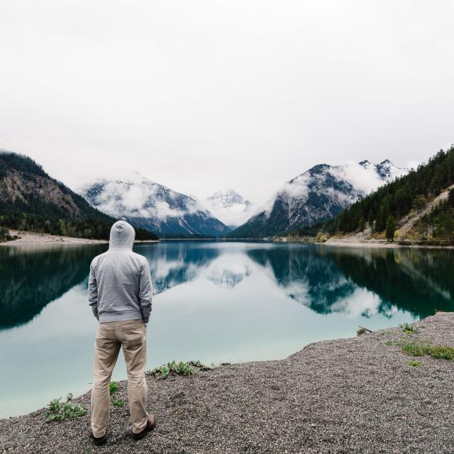"""""""Man looking at Plansee Lake"""" stock image"""