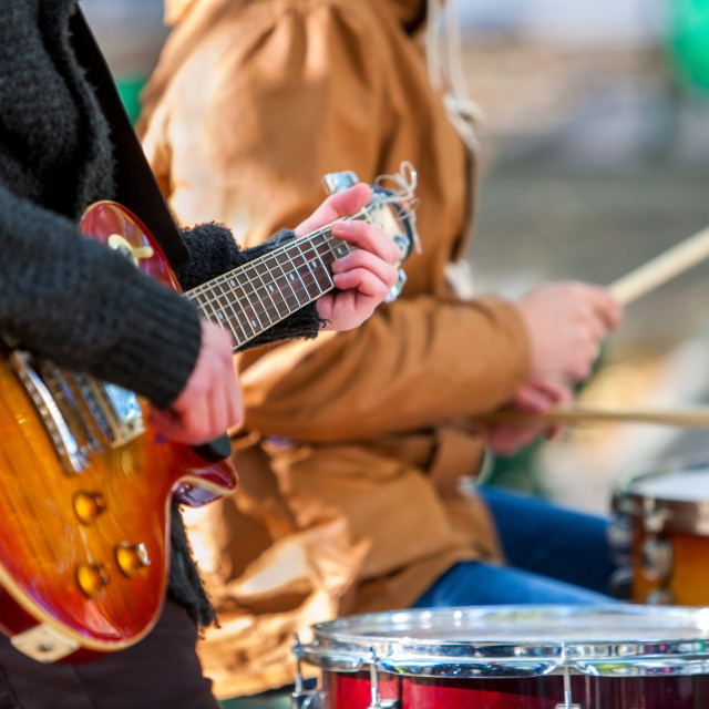 """Performance of street musicians with guitar."" stock image"