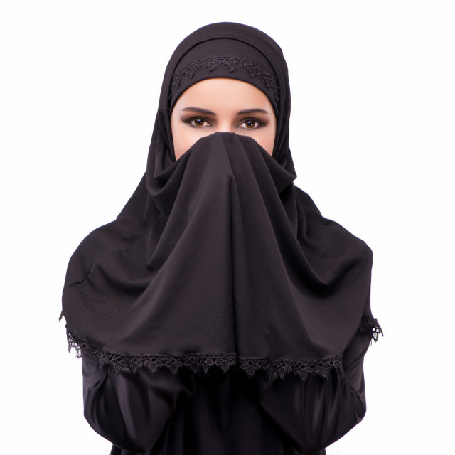 """Muslim woman in black dress isolated on white"" stock image"