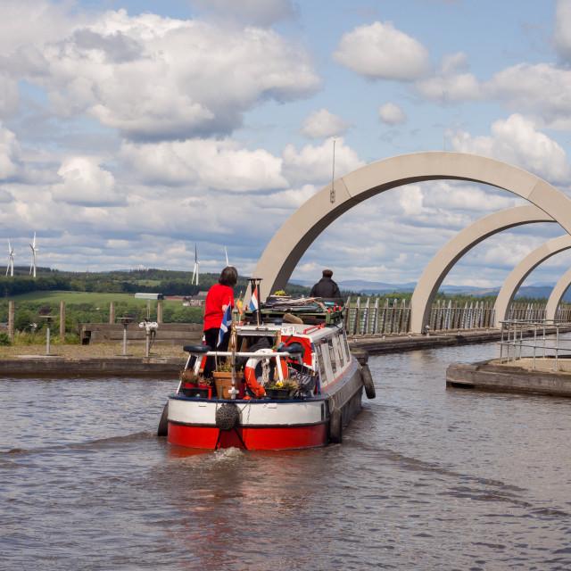 """Canal boat entering the boat gondola at The Falkirk Wheel boat lift"" stock image"