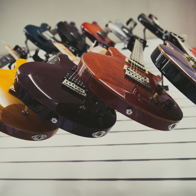 """Many electric guitars in the shop"" stock image"