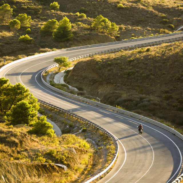 """Winding road with motor bike"" stock image"