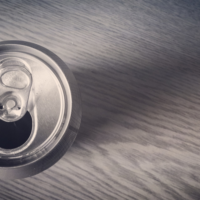 """Just a can, on a desk"" stock image"