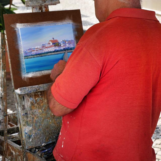 """Algarve street artist"" stock image"