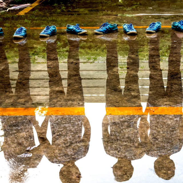 """""""Four man reflection in the water after raining, double exposure of shadow"""" stock image"""