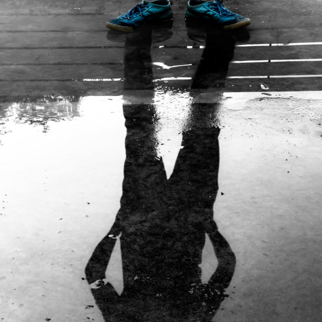 """""""The man reflection in the water after raining"""" stock image"""
