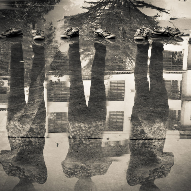"""""""Three man reflection in the water after raining, double exposure of shadow"""" stock image"""