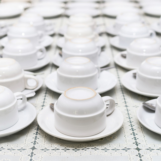 """""""Many rows of white coffee cup with saucer and teaspoon on table"""" stock image"""