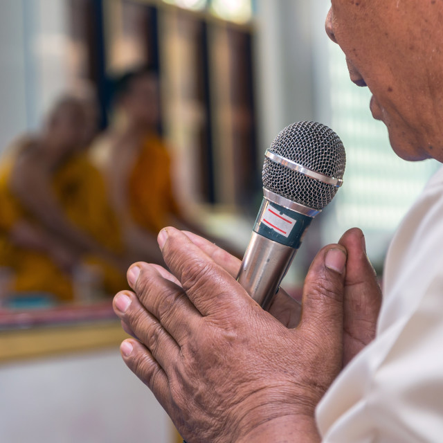 """Microphone on hand of The ordination ceremonyprocess with monk background"" stock image"
